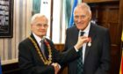 Frank Jordan received the British Empire Medal from Lord Provost Borthwick (left).