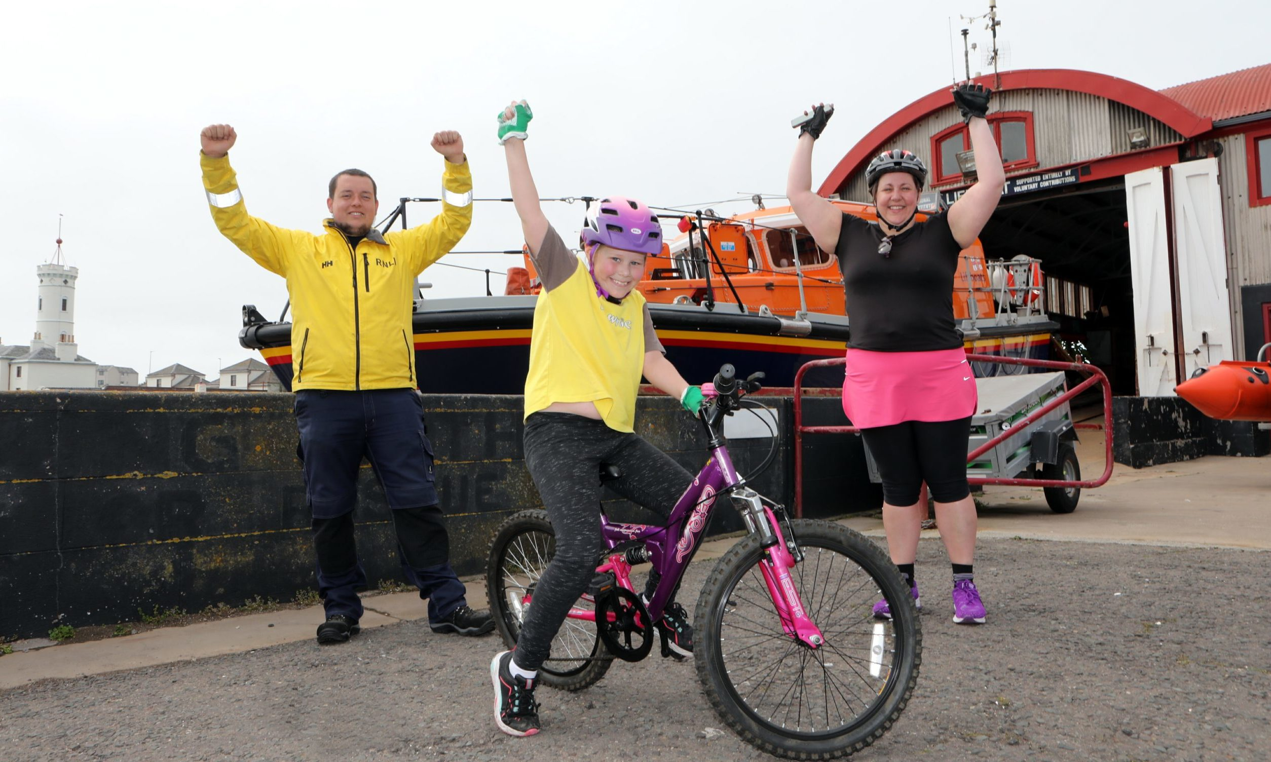 Kaylee celebrates at Arbroath lifeboat station with mum Dawn and Sam Clow, Arbroath RNLI coxswain/mechanic.