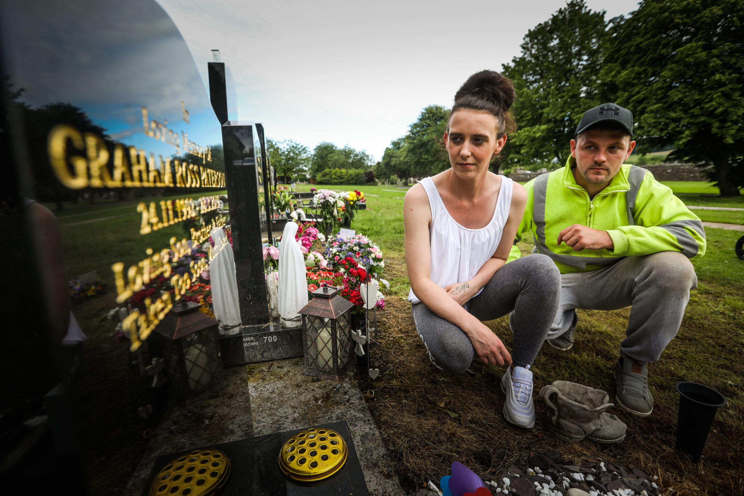 Graham's brother Scott Paterson, and Scott's partner Sarah Rodger at Graham's gravestone. Picture: Mhairi Edwards.