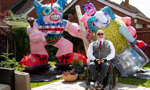 Disabled artist Jason Wilsher-Mills, who had been due to show his work at the Tate after winning the equivalent of the Turner Prize for disabled artists, has found new ways to work while self-isolating during the coronavirus pandemic by putting his giant inflatable sculptures on display in the back garden of his home in Sleaford, Lincolnshire. PA Photo. Picture date: Monday June 22, 2020. Photo credit should read: Jacob King/PA Wire