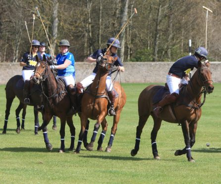 Action during a previous St Andrews Polo Tournament to raise cash for Help for Heroes.