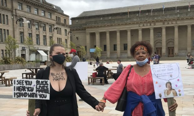 Lucie Lange, from Germany and Kathy McLemore of Ohio at the Dundee protest.