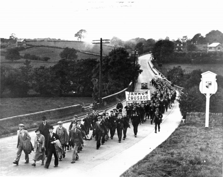 Unemployed miners and shipbuilders take part in the Jarrow march to London in 1936. The economic decline in the UK in April was greater even than that seen in the Great Depression.