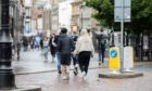 Shoppers in Dundee city centre as certain shops reopened following lockdown.