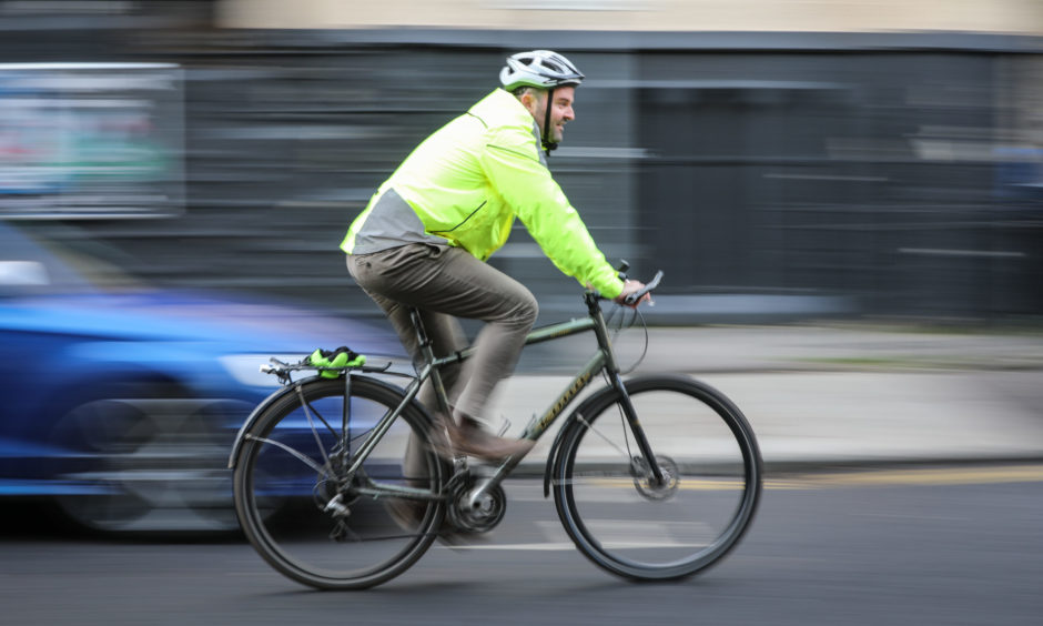 Man cycling in Dundee