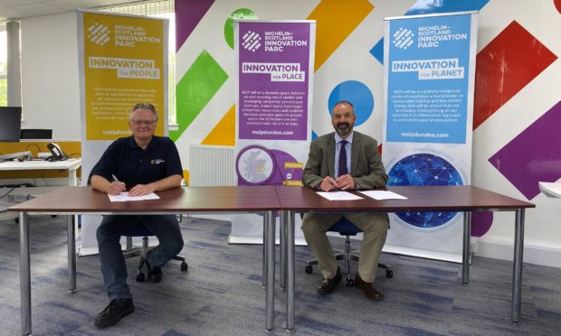 John Reid, MSIP chief executive and John Rowan from the University of Dundee sign a memorandum of understanding last month.
