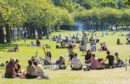 People gathered in the Meadows in Edinburgh after lockdown restrictions were eased.
