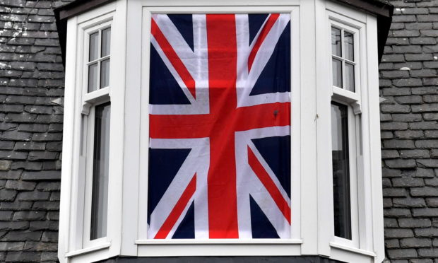 A Union Jack displayed in a window of an Aberdeenshire home.