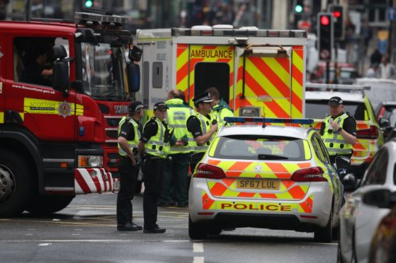Emergency services at the scene in West George Street, Glasgow, where a man has been shot by an armed officer after another police officer was injured during an attack. PA Photo. Picture date: Friday June 26, 2020. See PA story POLICE WestGeorgeSt. Photo credit should read: Andrew Milligan/PA Wire