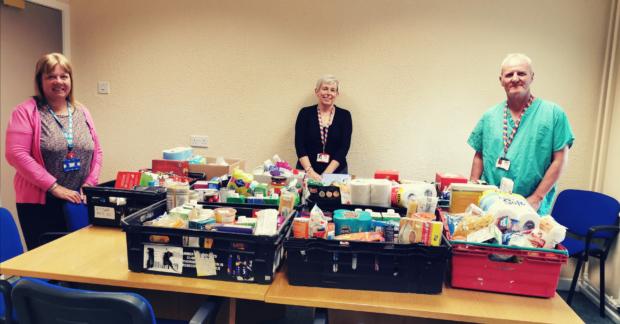 Medical Secretary, Jane Aitken, Medical Secretary, Lorna Robertson and Support Worker, John Coyle with foodbank donations.