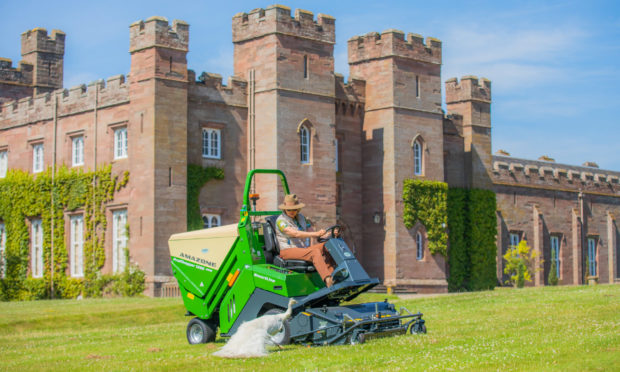 Lady Mansfield mowing the grass in June 2020, in preparation for the reopening of Scone Palace.