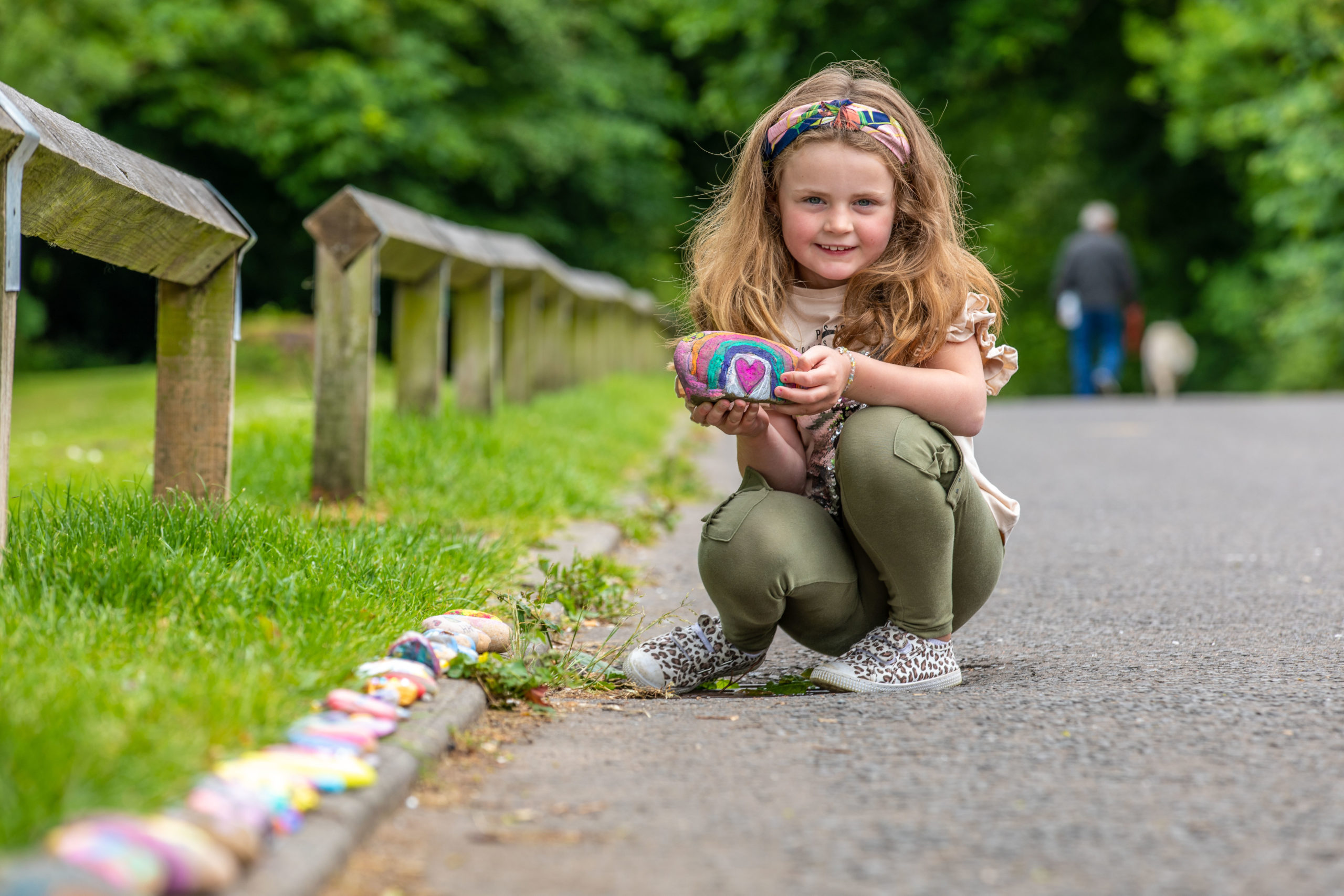 Gracie Gilmour from Leslie placing stone on the 'snail trail' at Gilvenbank Park.