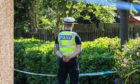 Police stand guard following the incident in Glenrothes last week.