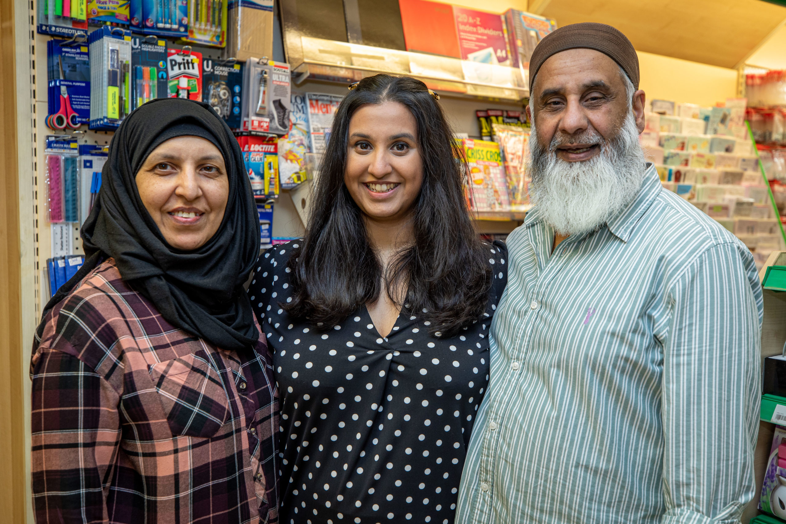 Miriam Hussain with parents Fatima and Fateh at the family business.