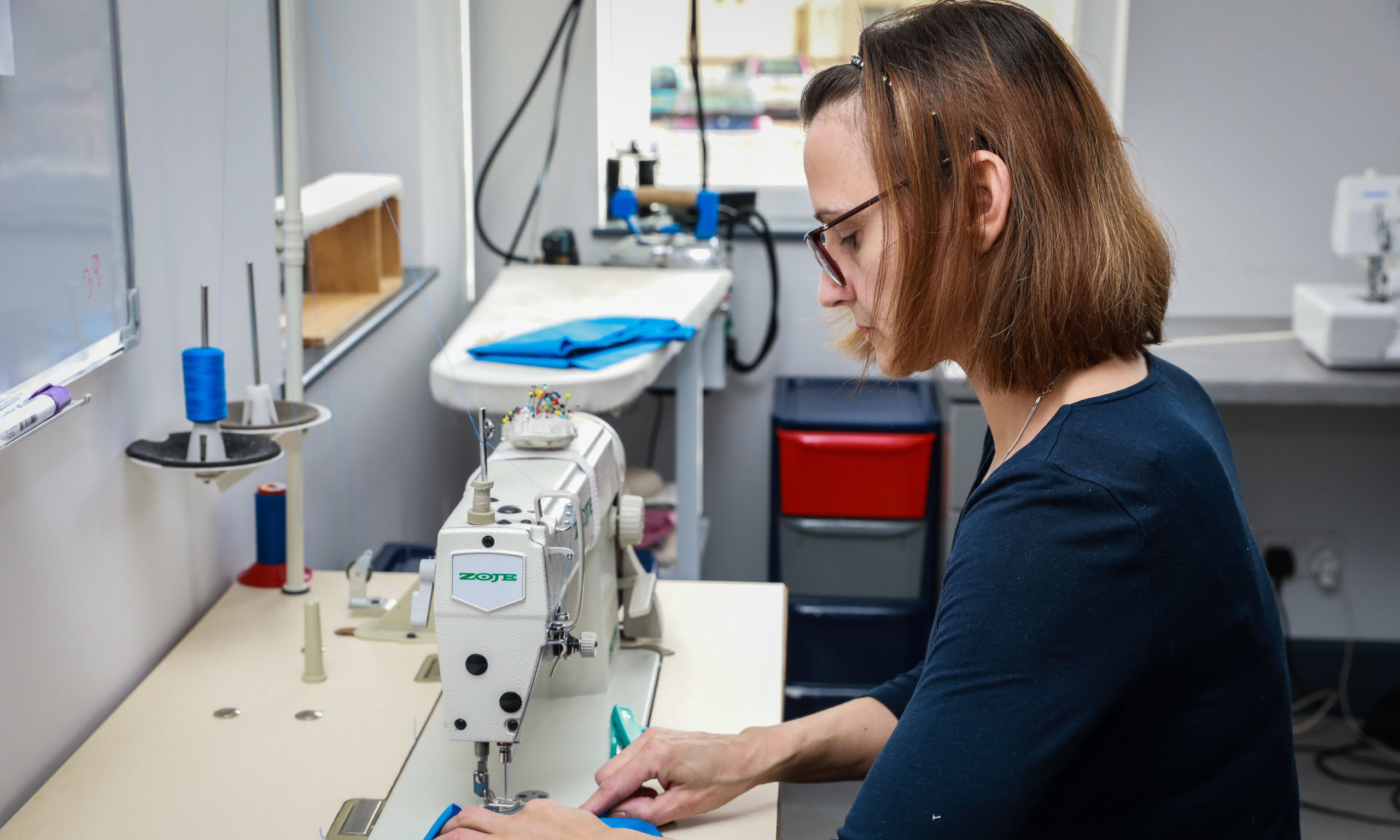 Mirka at work in her shop.