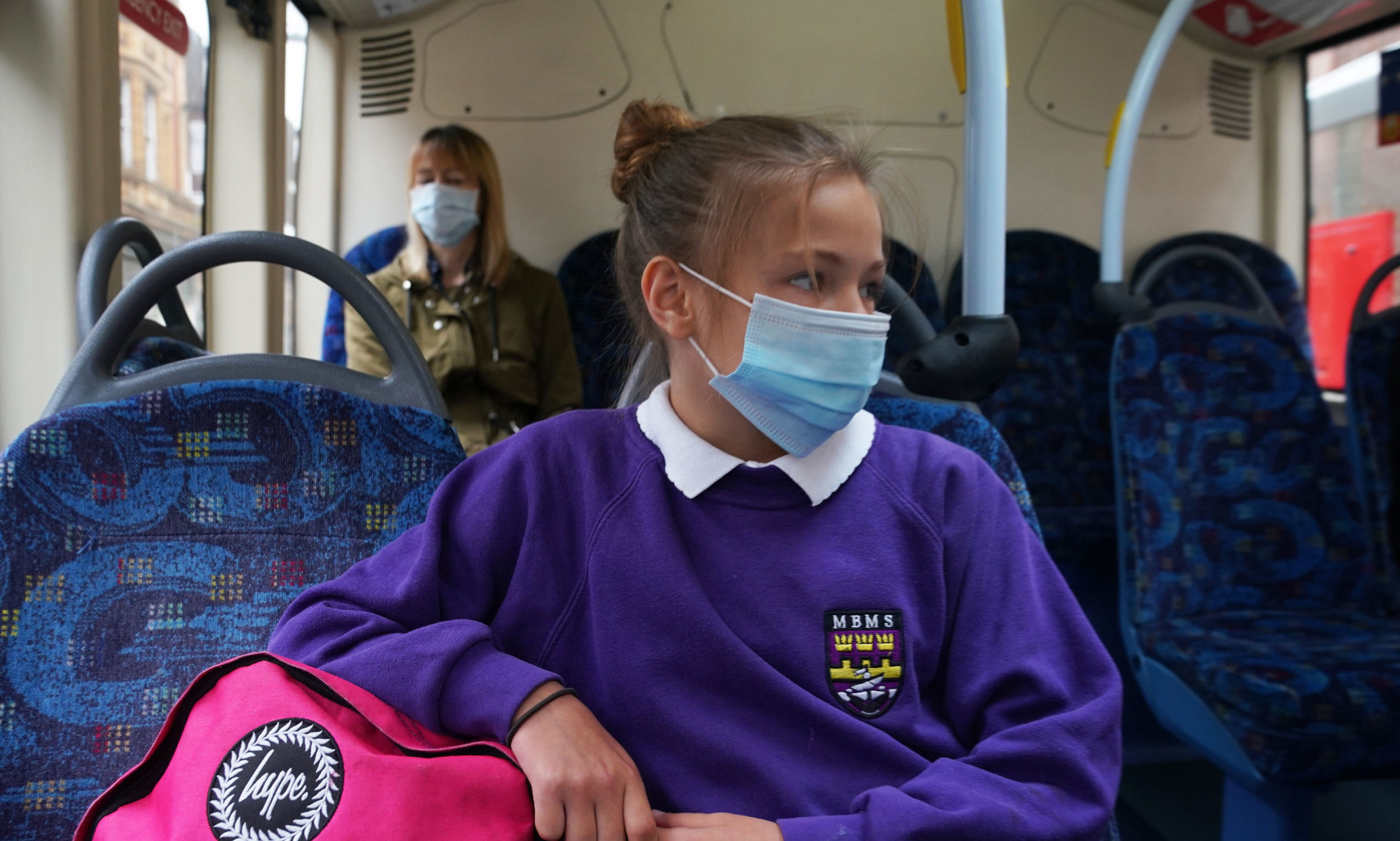 It remains unclear whether children will have to distance and wear face masks on school buses.