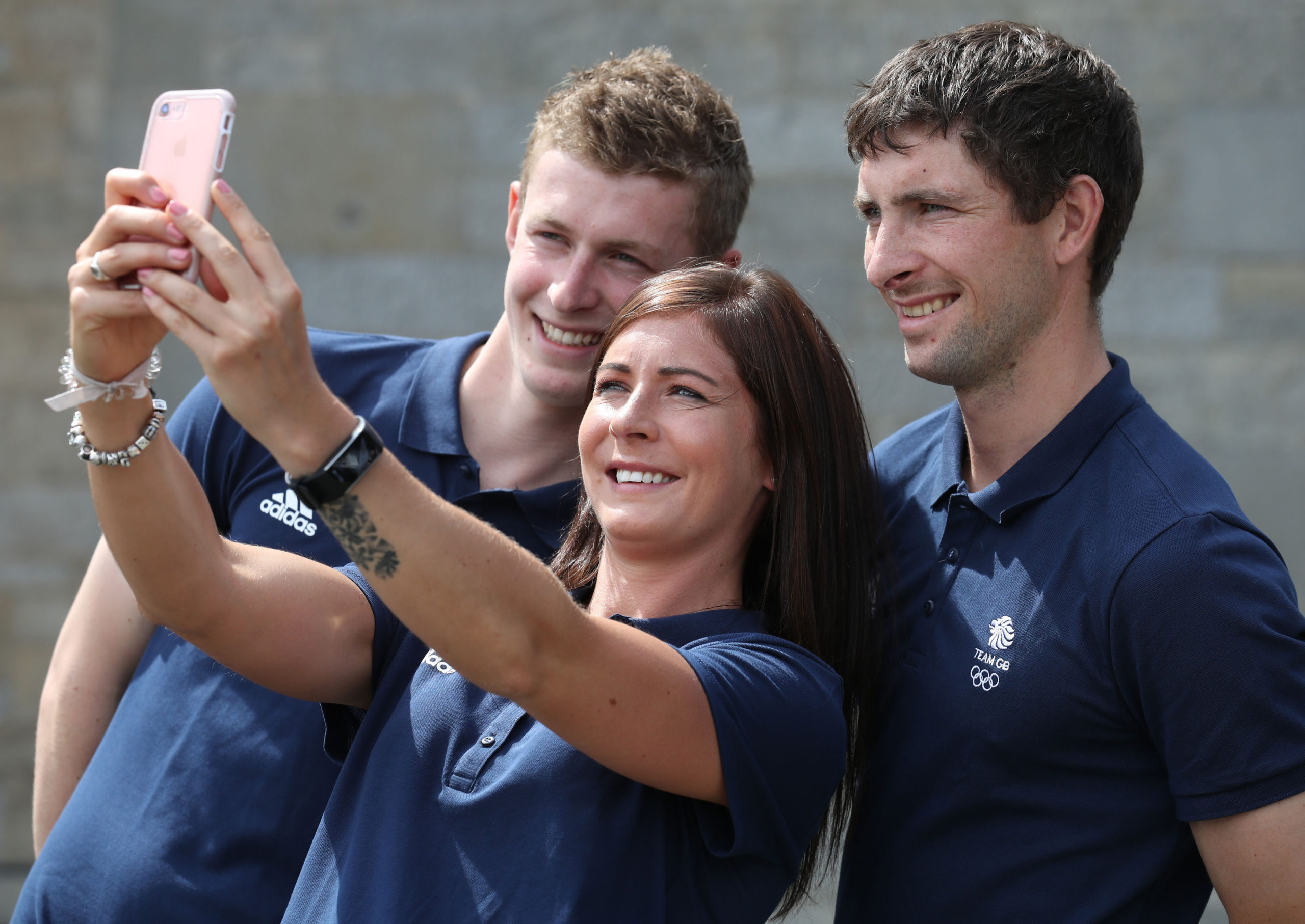 Eve with her brothers Thomas (left) and Glen when they were selected for the 2018 Winter Olympics.