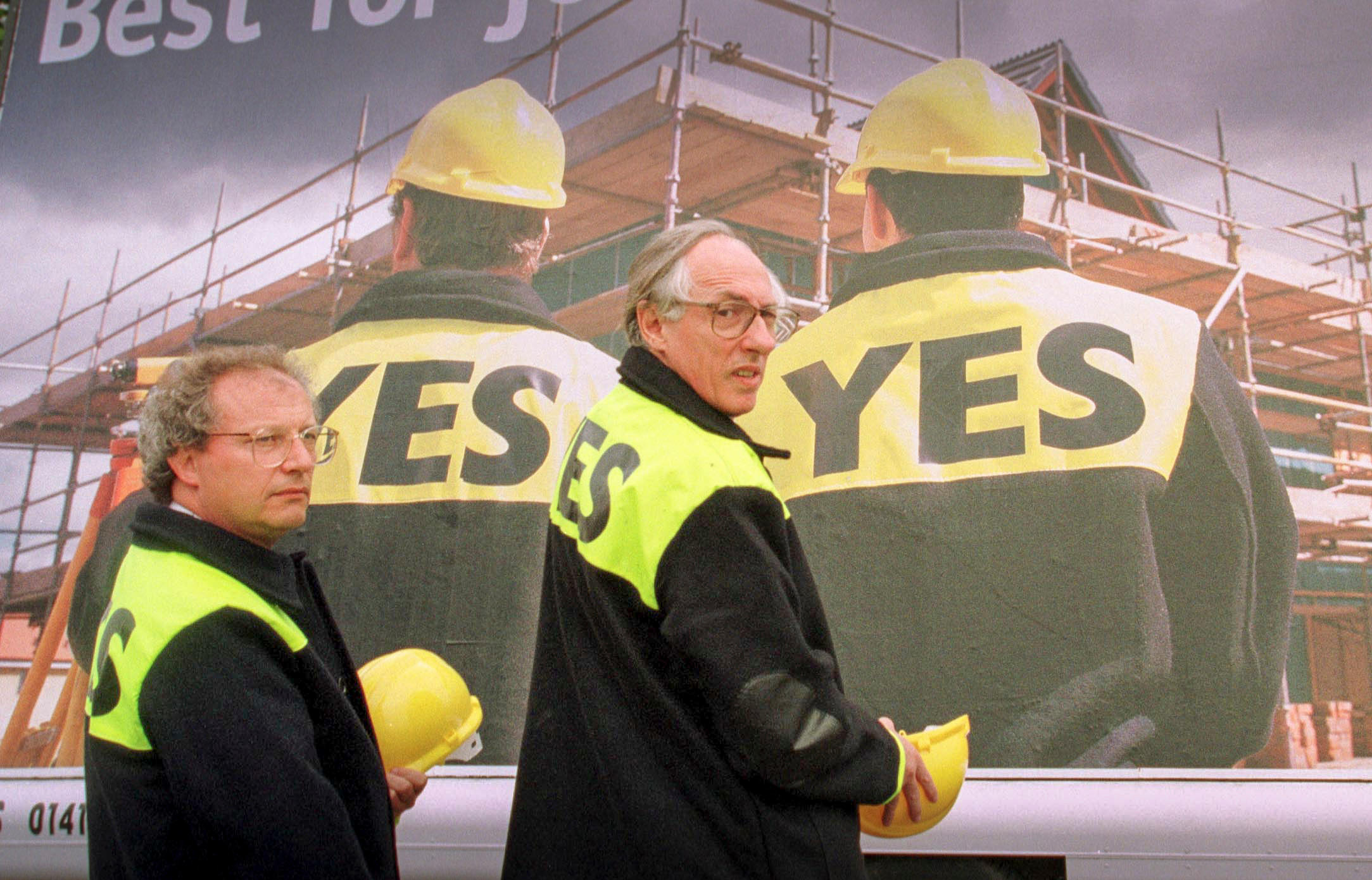 Donald Dewar and Henry Mcleish in front of Yes to Devolution billboards in Glasgow 1997.