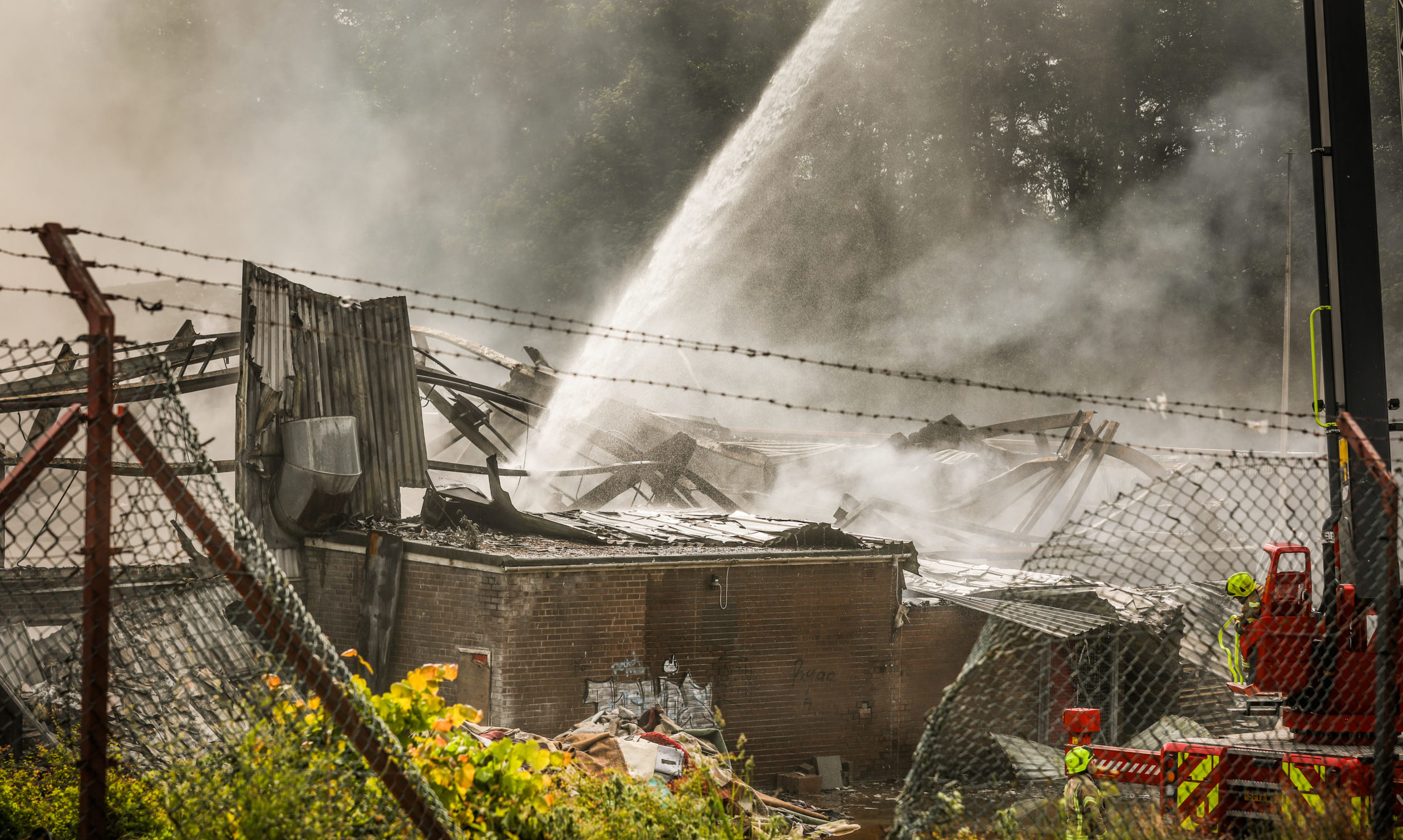 The smoking remains of the fire-hit building at Baldovie Industrial Estate.