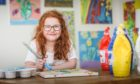 The Evening Telegraph, CR0021598, News, Lindsey Hamilton story, Budding artist Lauren Chesters, 7, has sold t-shirts she designed and has raised more than £600 for Dundee Bairns. Picture shows; Lauren Chesters, 7, doing what she does best. Saturday 30th May, 2020. Mhairi Edwards/DCT Media