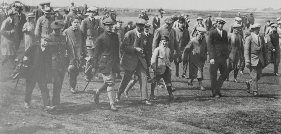 The crowd following legendary golfer George Duncan.
