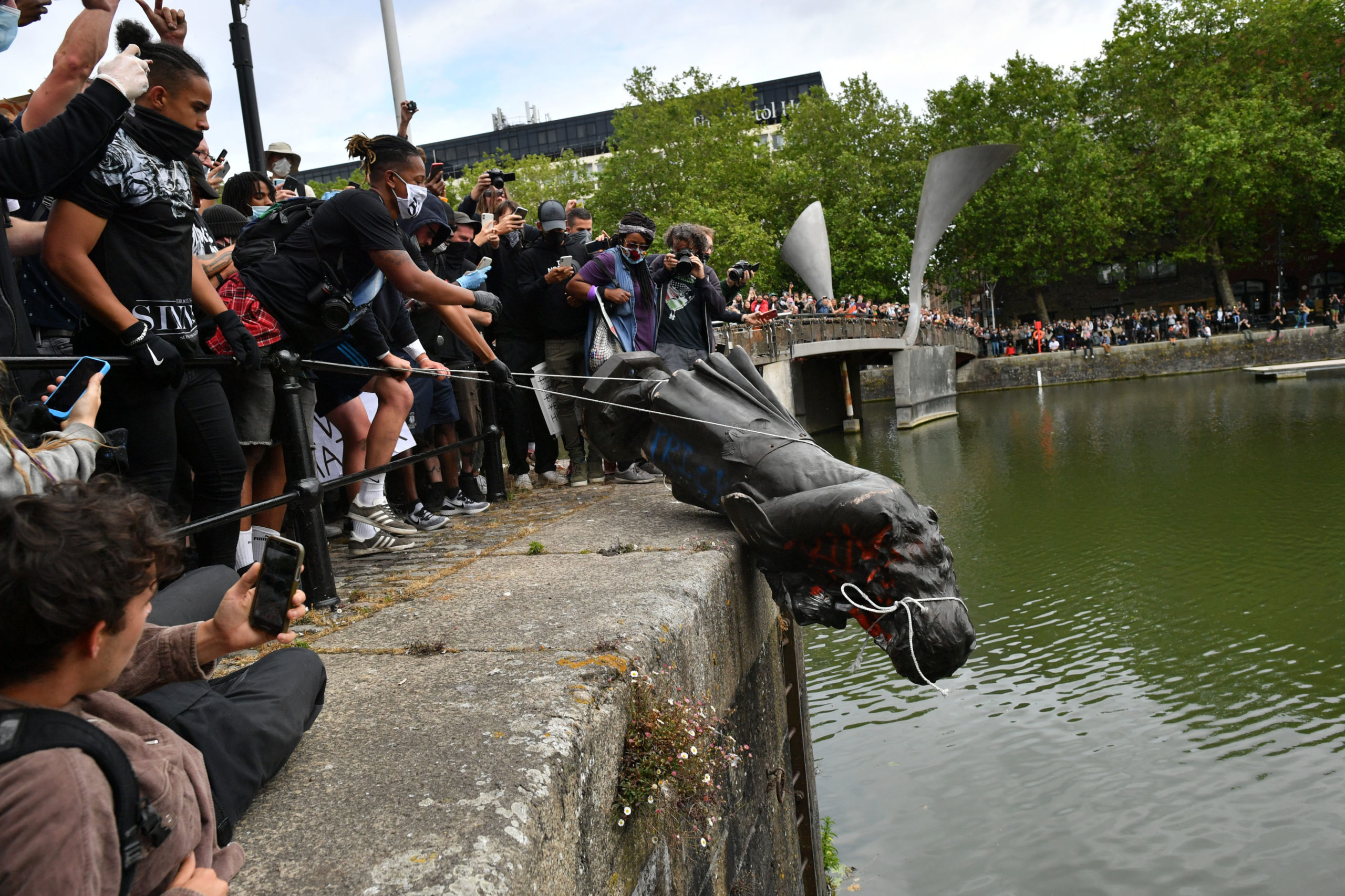 Protesters throw a statue of Edward Colston into Bristol harbour during a Black Lives Matter protest rally.
