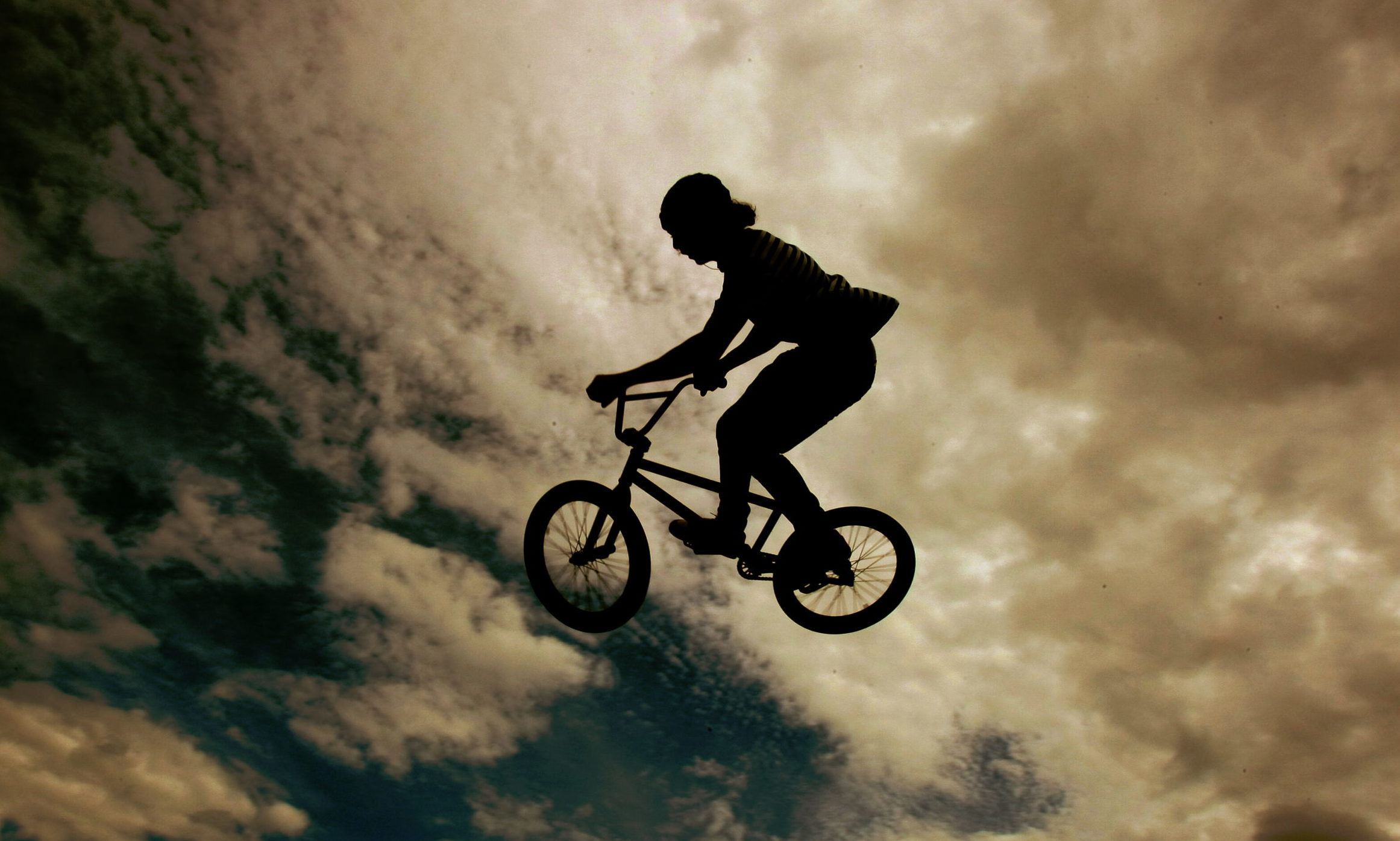 Dudhope Park, Dundee.    Fun Day.   Sam Hart gets some height on the BMX / Skate park.