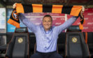 United's new boss Micky Mellon gets comfy in the Tannadice dugout.