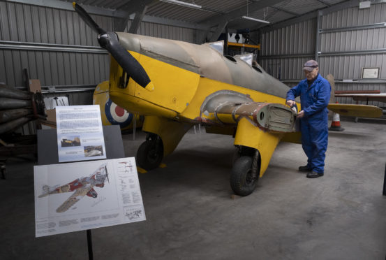 Volunteer Andy Lawrence with the rare Miles Hawk major at the heritage centre before lockdown.