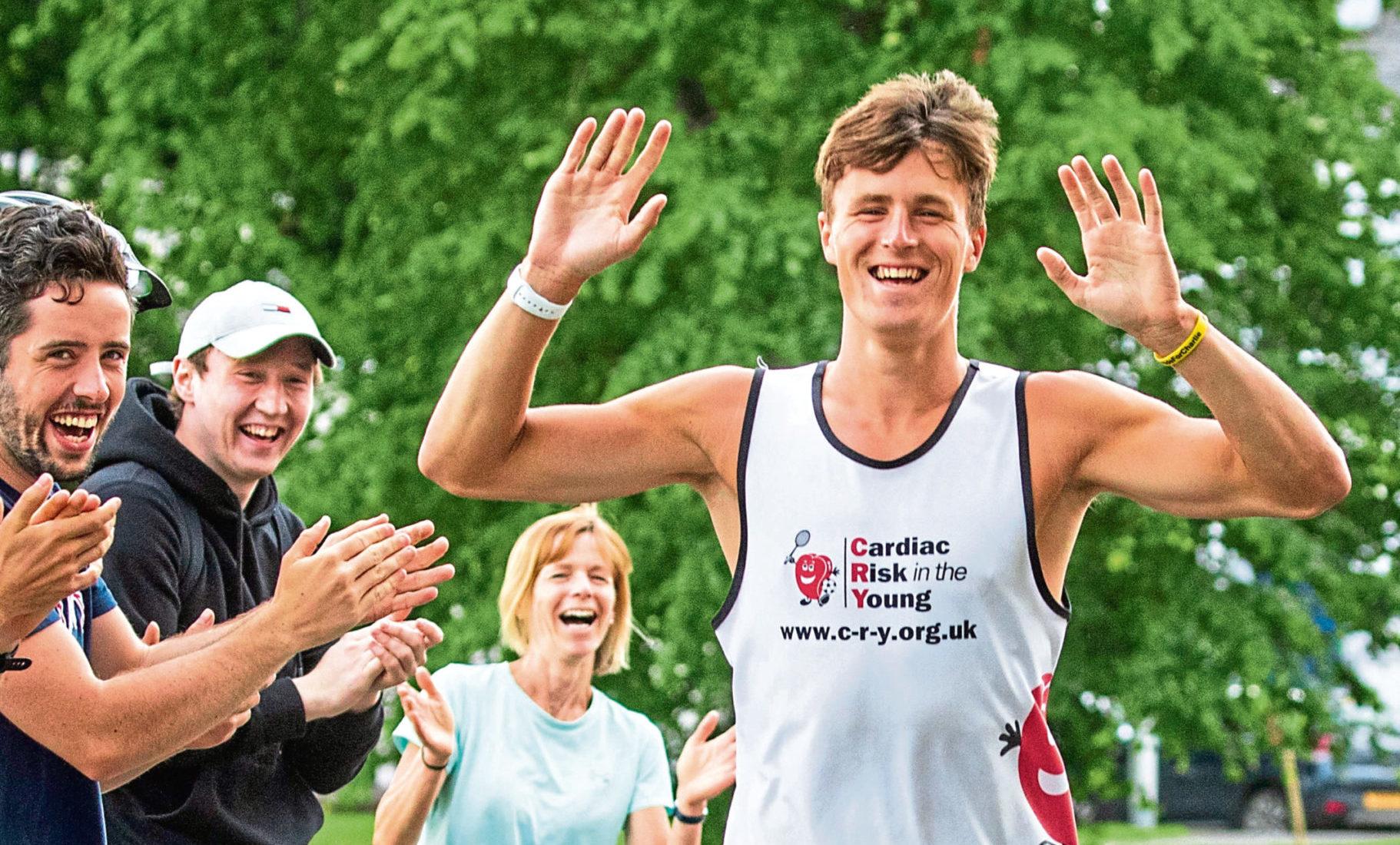 Mark McGuire completes his marathon challenge.