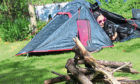 "Gayle and her dog Toby set up a tent in the garden as part of  a Scouts Scotland ""at home"" challenge."