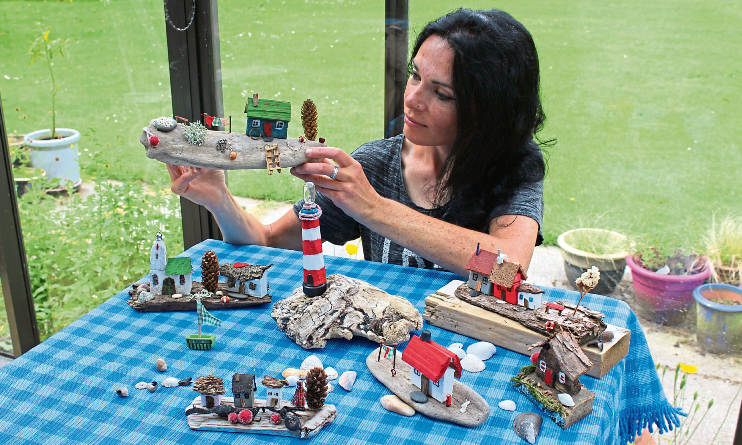 Gayle crafted her own driftwood village - cobbled together from seaside scraps found at Forvie Sands in Aberdeenshire.