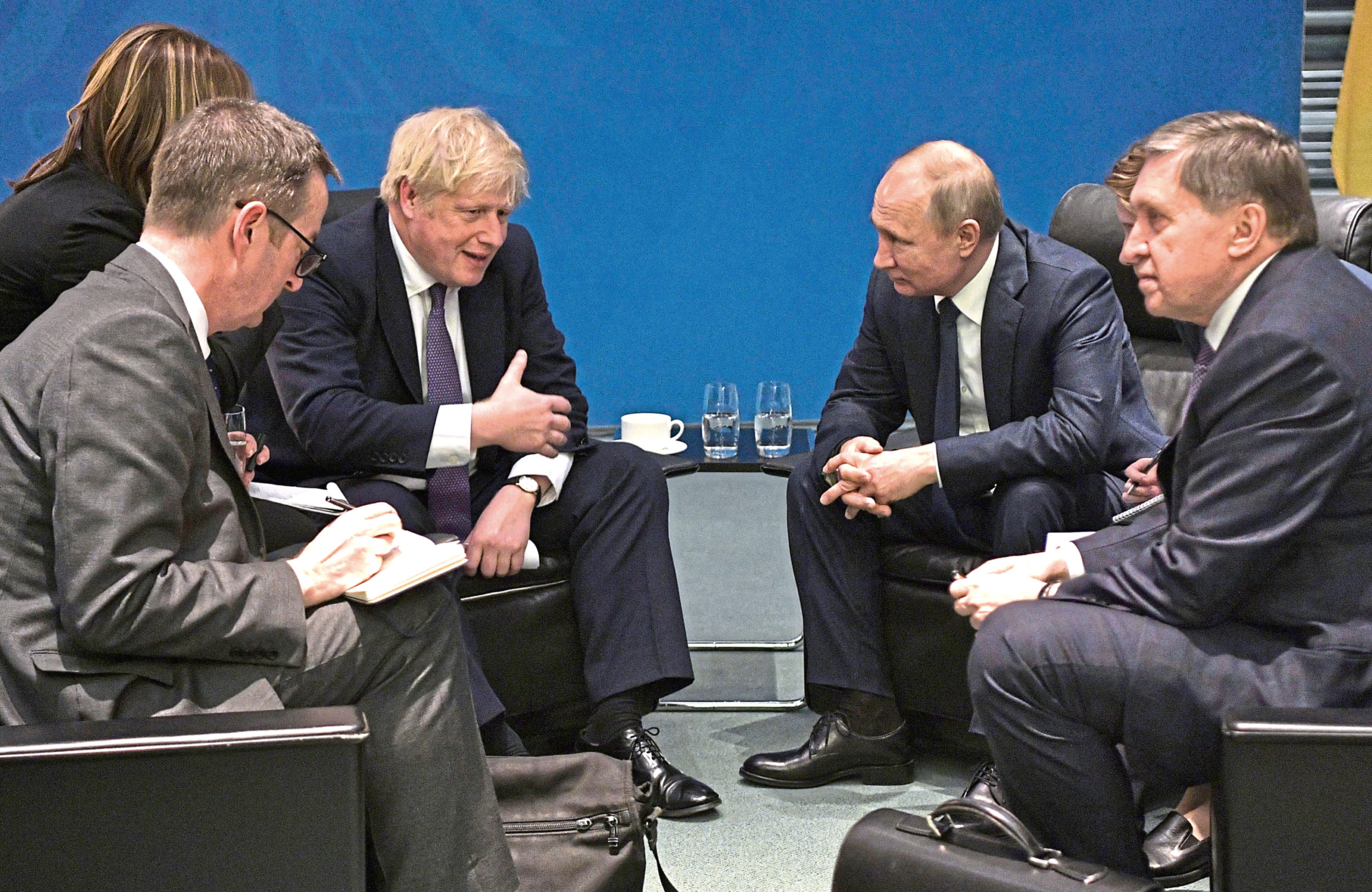 Boris Johnson (third left) speaks to Russian President Vladimir Putin (second right) during the International Libya Conference in Berlin, Germany, in January 2020.