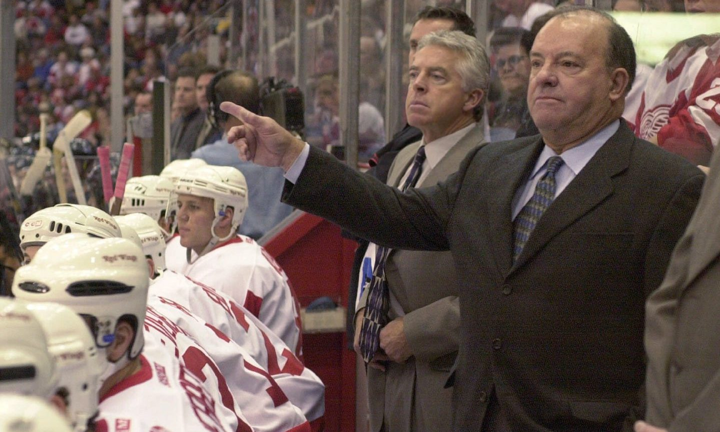 Scotty Bowman, right, gives his team directions during a game against the Vancouver Canucks, at Joe Louis Arena in Detroit. The game was Bowman's 2,000th as an NHL coach.