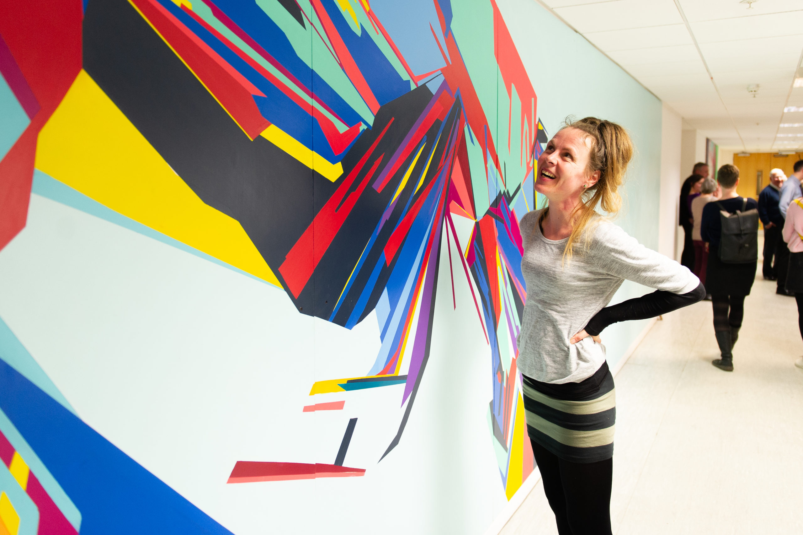 Artist Joanna Craig and her artwork, part of a project to illustrate the story of NCR in Dundee.