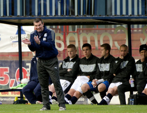 Barry Smith in the Dens Park dugout in September 2012 during a defeat to St Johnstone.