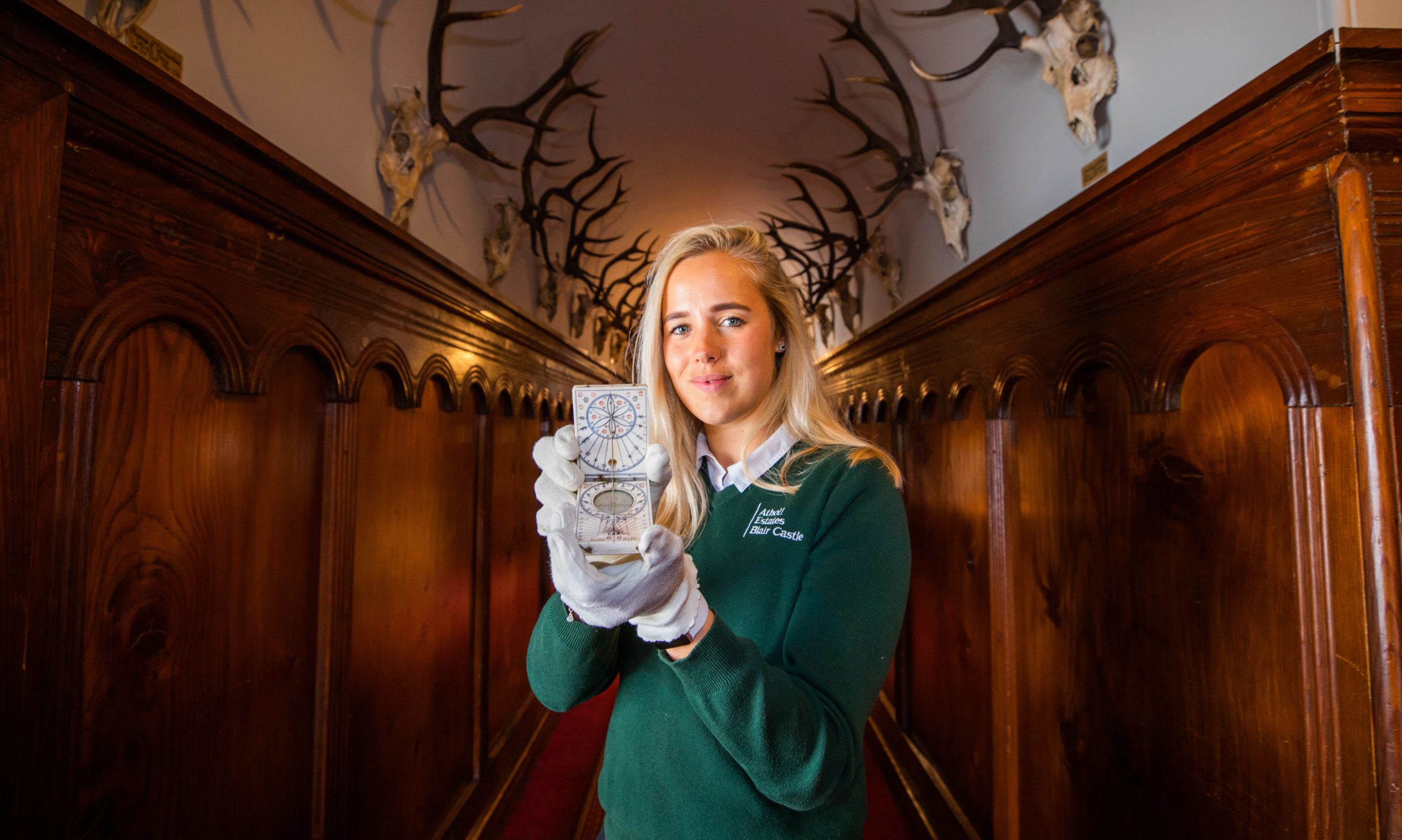 Chloe Thorton holding Bonnie Prince Charlie's compass