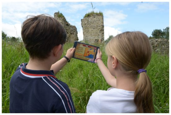 In the Footsteps of Kings, an augmented reality app which allows visitors to trace the steps of historic royal at locations across central Fife. Pictured is Cameron Robertson, 8, and Lily Riach, 10.