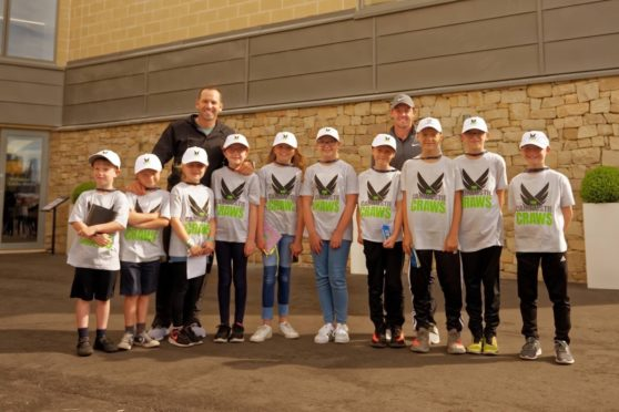 Carnoustie Craws youngsters during the 2018 Open Championship with star players Sergio Garcia and Rory McIlroy.