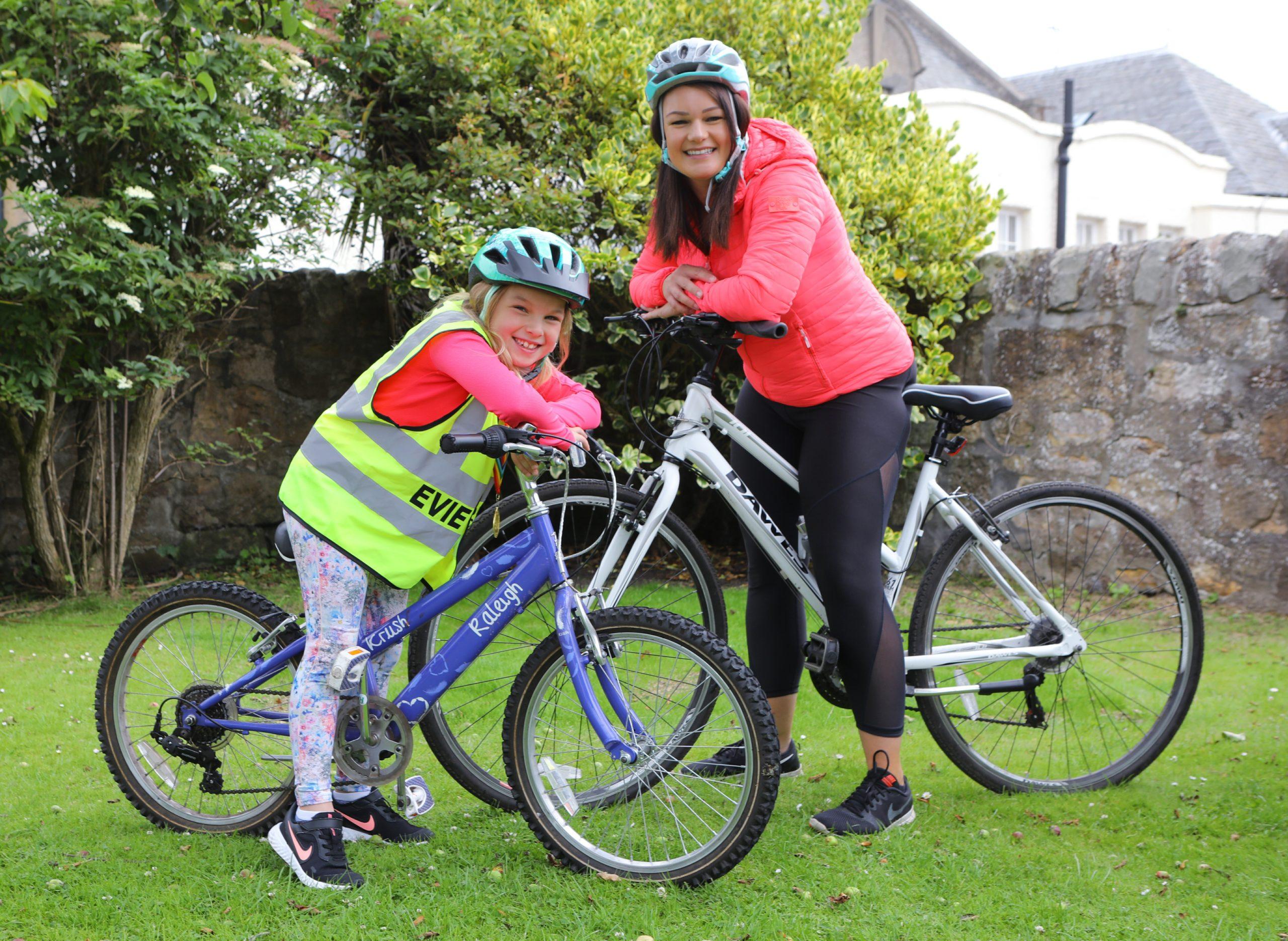 Evie Hughes and her mum Rachel celebrate raising £2,400 for three East Neuk charities.