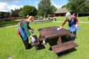 Cleaners Jamie Sheilds, left, and Wendy Greenhill wiping down one of the picnic benches at Glamis Castle.