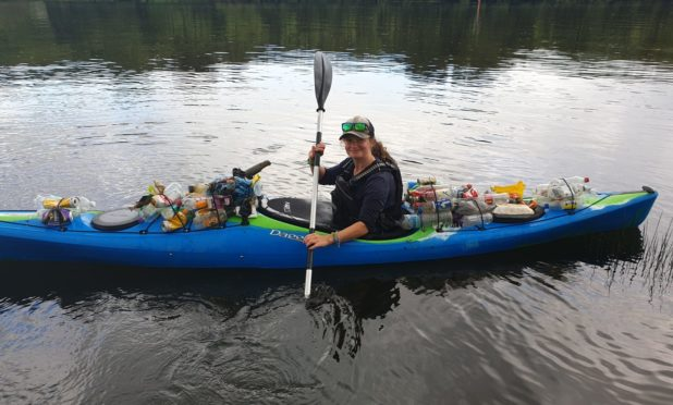 Emily Hamilton-Peach, assistant manager at Willowgate, with rubbish collected from the River Tay