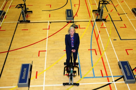 Emma Walker demonstrating new social distancing measures at one of Fife's leisure centres.
