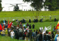Police reinforcements (top) are drafted in by helicopter, after protestors breached the security fence at Auchterarder surrounding the G8 summit at Gleneagles in July 2005.