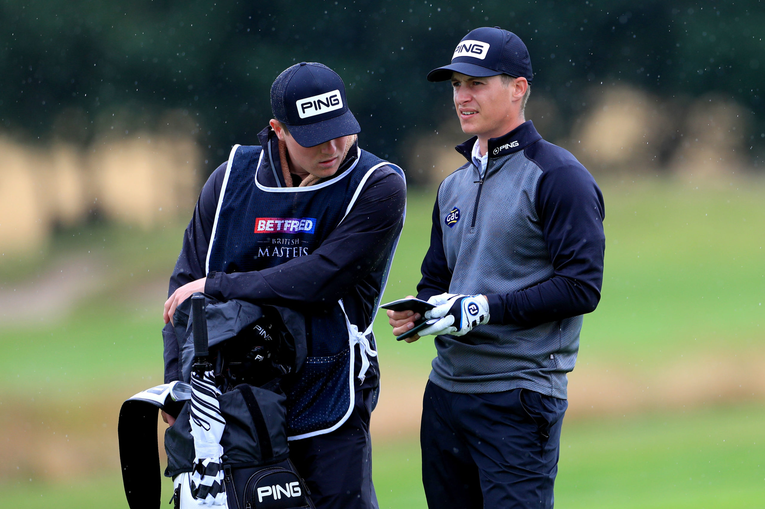 Calum Hill consults with brother and caddie Ian during the second round at Close House.