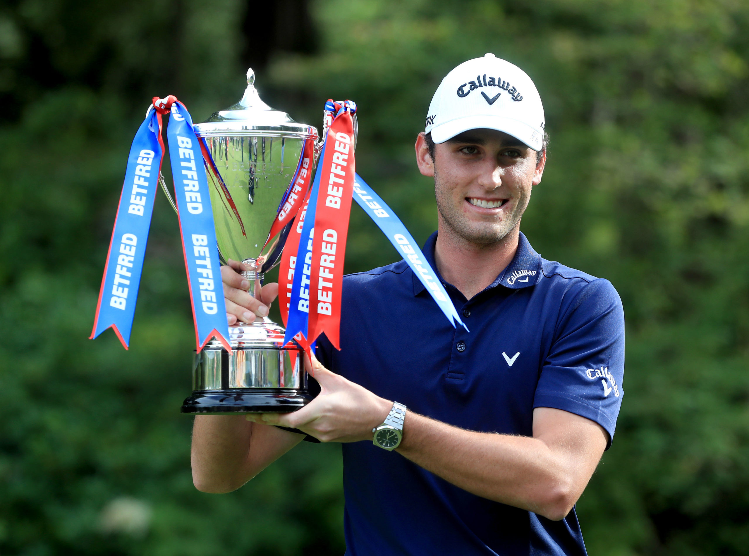 Italy's Renato Paratore with the trophy after his win Close House.