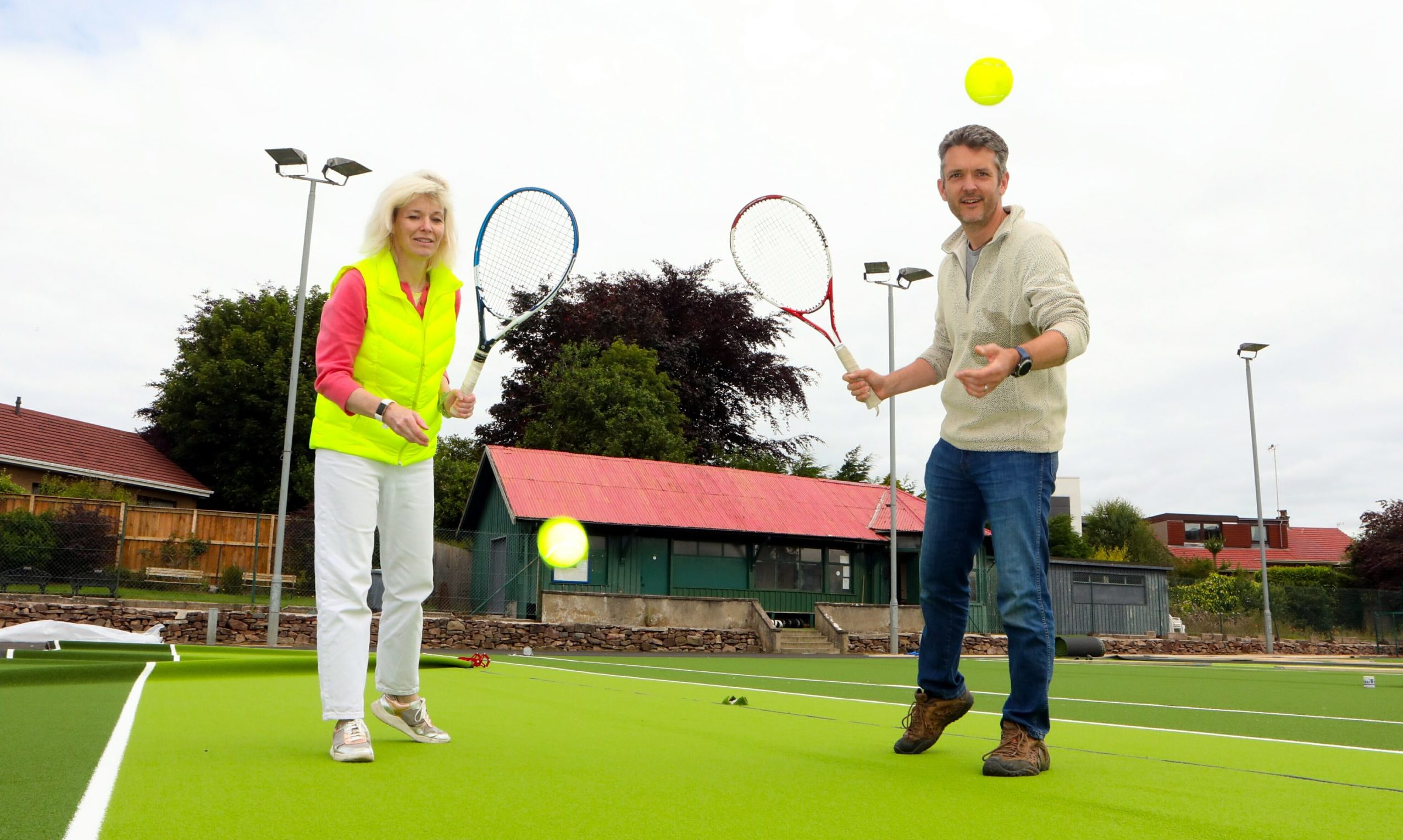 Club president Amanda Barclay and member Colin Birtwistle on the new courts as the project nears completion.