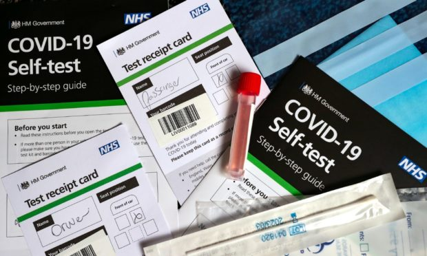 A COVID-19 self testing kit as further coronavirus lockdown restrictions are lifted in England. PA Photo. Picture date: Thursday July 2, 2020. See PA story HEALTH Coronavirus. Photo credit should read: Peter Byrne/PA Wire