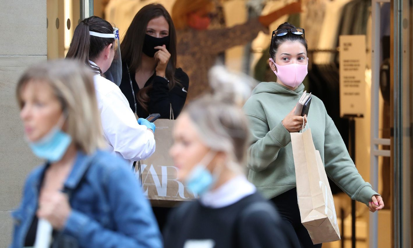Shoppers return to stores across Scotland as new face mask rules are put in place.