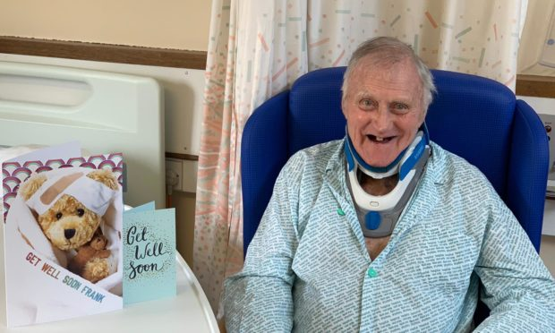 Frank Jordan in hospital with cards from well-wishers.